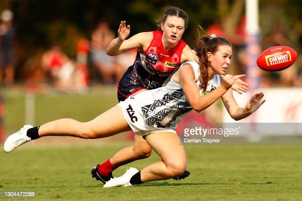 Tarni Brown of Collingwood handballs during the round five AFLW match between the Collingwood Magpies and the Melbourne Demons at Victoria Park on...