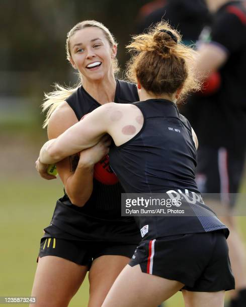 Tarni White of the Saints is tackled by Tilly Lucas-Rodd of the Saints during the St Kilda training session at RSEA Park on October 14, 2021 in...