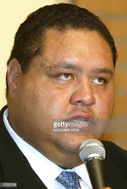 Taro Akebono Japan's first foreignborn sumo grand champion answers a question during a news conference at a hotel in Tokyo 06 November 2003 The...