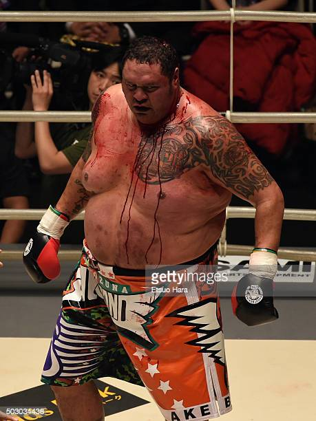 Taro Akebono of Japan coverd in blood in the bout Rizin Fighting World Grand Prix against Bob Sapp of the United States during the Rizin Iza...