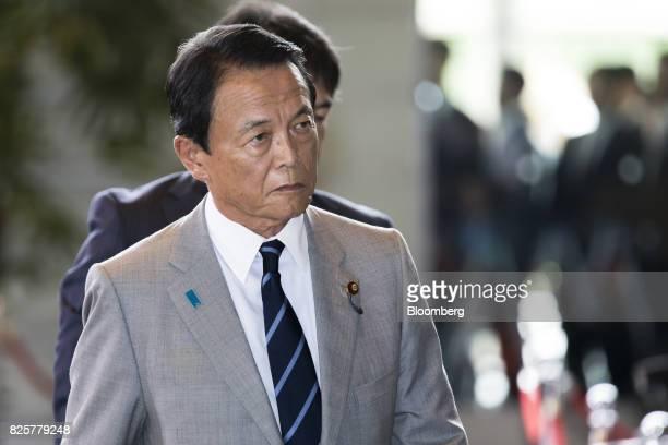 Taro Aso Japan's deputy prime minister and finance minister arrives at the Prime Minister's official residence in Tokyo Japan on Thursday Aug 3 2017...