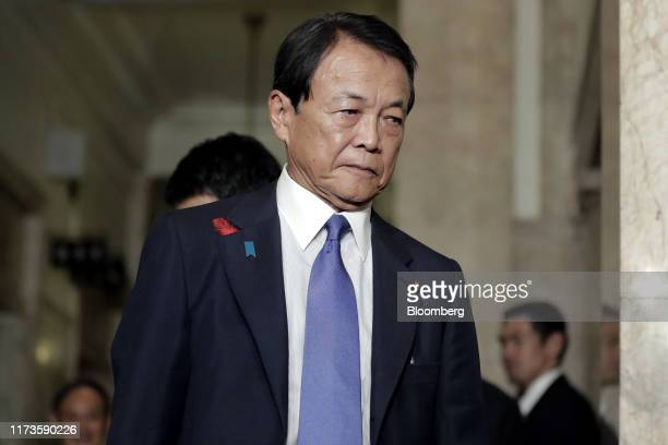 Taro Aso, Japan's deputy prime minister and finance minister, arrives for an extraordinary session at the lower house of parliament in Tokyo, Japan,...