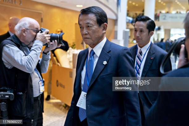 Taro Aso, Japan's deputy prime minister and finance minister, arrives to a Group of 20 and finance ministers and central bank governors meeting on...