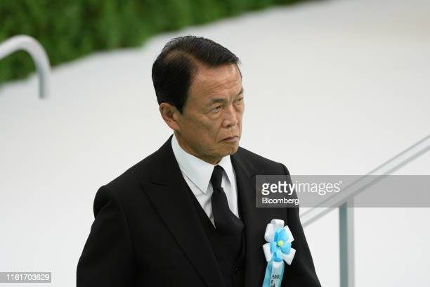 Taro Aso, Japan's deputy prime minister and finance minister, attends a memorial service marking the 74th anniversary of the end of World War II at...