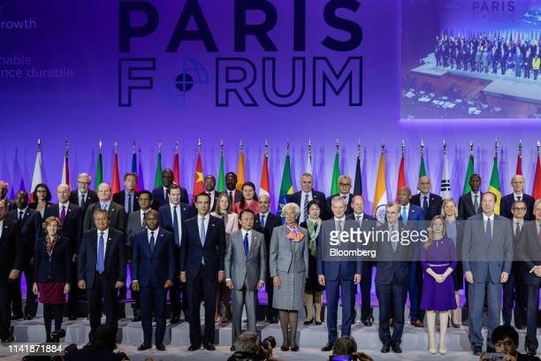 Taro Aso Japan's deputy prime minister and finance minister center left Christine Lagarde managing director of the International Monetary Fund center...