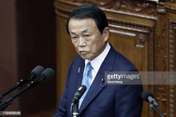Taro Aso, Japan's deputy prime minister and finance minister, delivers a speech during an ordinary session at the lower house of the parliament in...