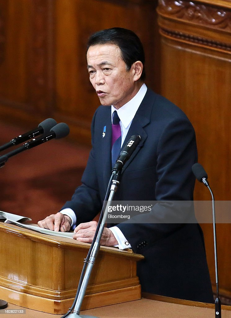 Taro Aso, Japan's deputy prime minister and finance minister, delivers his policy speech at the lower house of Parliament in Tokyo, Japan, on Thursday, Feb. 28, 2013. Aso said Japan's fiscal state is very grim, and the government can't provide fiscal stimulus perpetually. Photographer: Haruyoshi Yamaguchi/Bloomberg via Getty Images