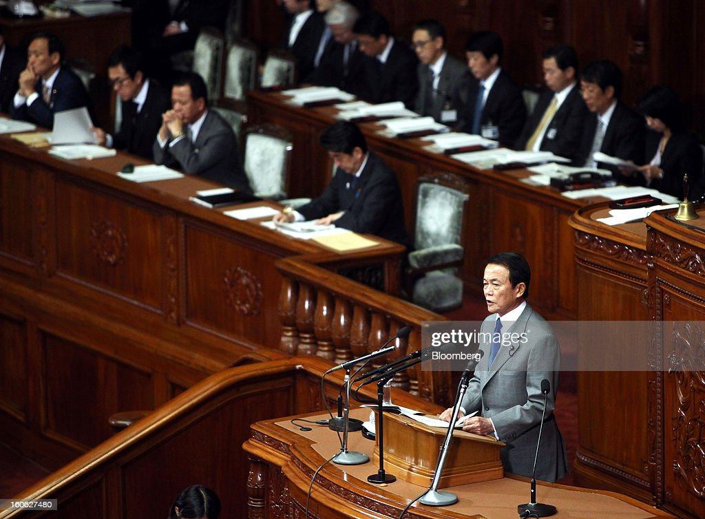 Taro Aso, Japan's deputy prime minister and finance minister, front, speaks during a plenary session at the lower house of Parliament in Tokyo, Japan, on Monday, Feb. 4, 2013. Aso said Japan will keep monitoring the currency markets carefully. Photographer: Haruyoshi Yamaguchi/Bloomberg via Getty Images