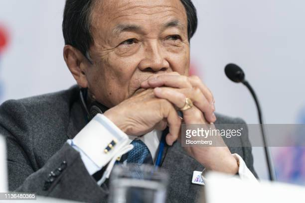Taro Aso, Japan's deputy prime minister and finance minister, listens during a Group of 20 finance ministers and central bank governors news...