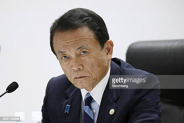 Taro Aso Japan's deputy prime minister and finance minister listens during a news conference following the Group of Seven finance ministers and...