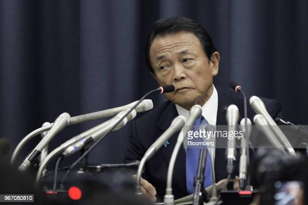 Taro Aso Japan's deputy prime minister and finance minister listens during a news conference in Tokyo Japan on Monday June 4 2018 Asowill take a...