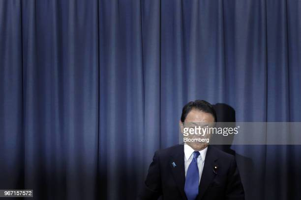 Taro Aso Japan's deputy prime minister and finance minister prepares to leave a news conference in Tokyo Japan on Monday June 4 2018 Asowill take a...