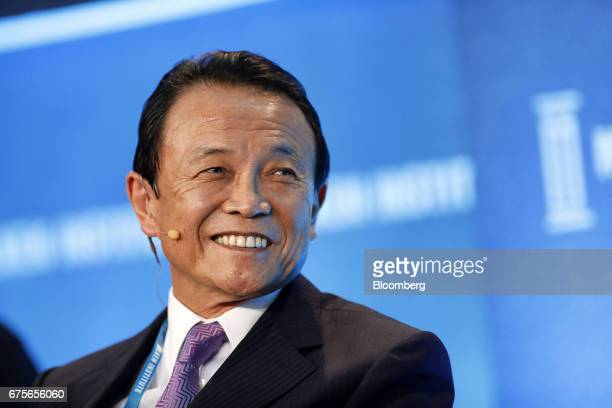 Taro Aso Japan's deputy prime minister and finance minister reacts during the Milken Institute Global Conference in Beverly Hills California US on...
