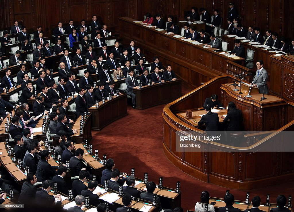 Taro Aso, Japan's deputy prime minister and finance minister, right, speaks during a plenary session at the lower house of Parliament in Tokyo, Japan, on Monday, Feb. 4, 2013. Aso said Japan will keep monitoring the currency markets carefully. Photographer: Haruyoshi Yamaguchi/Bloomberg via Getty Images