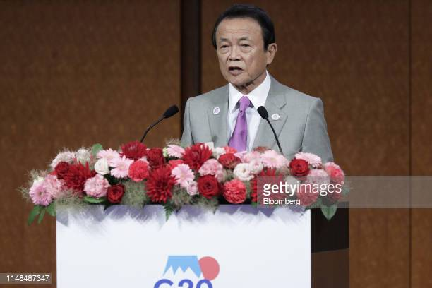 Taro Aso Japan's deputy prime minister and finance minister speaks during a seminar on financial innovation at the Group of 20 finance ministers and...