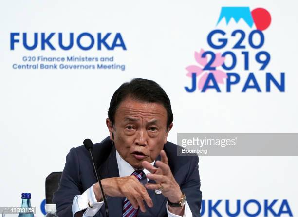 Taro Aso, Japan's deputy prime minister and finance minister, speaks during a news conference at the Group of 20 finance ministers and central bank...