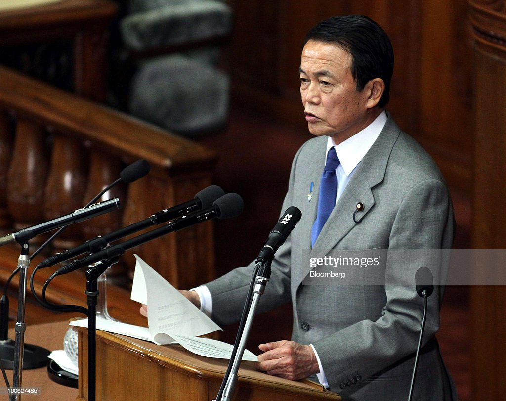Taro Aso, Japan's deputy prime minister and finance minister, speaks during a plenary session at the lower house of Parliament in Tokyo, Japan, on Monday, Feb. 4, 2013. Aso said Japan will keep monitoring the currency markets carefully. Photographer: Haruyoshi Yamaguchi/Bloomberg via Getty Images