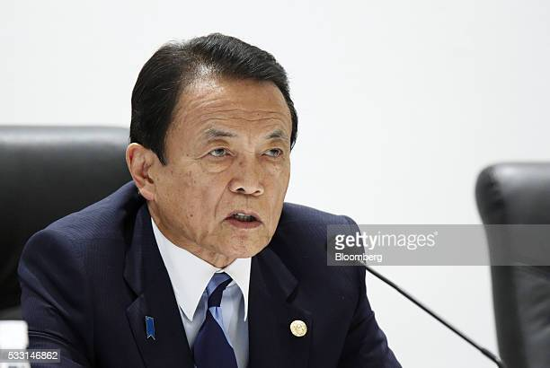 Taro Aso Japan's deputy prime minister and finance minister speaks during a news conference following the Group of Seven finance ministers and...
