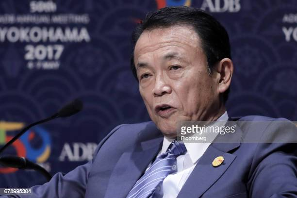 Taro Aso Japan's deputy prime minister and finance minister speaks during the 50th Asian Development Bank Annual Meeting in Yokohama Japan on Friday...
