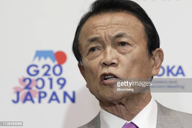 Taro Aso Japan's deputy prime minister and finance minister speaks to members of the media on the sidelines of the G20 finance ministers and central...