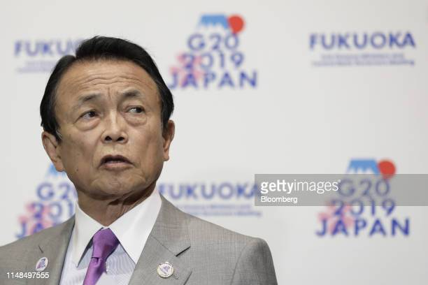 Taro Aso, Japan's deputy prime minister and finance minister, speaks to members of the media on the sidelines of the G-20 finance ministers and...