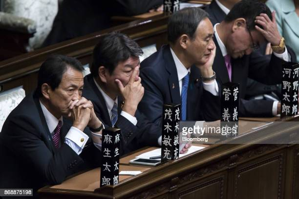 Taro Aso Japan's finance minister and deputy prime minister from left Toshimitsu Motegi Japan's economic revitalization minster Yoshihide Suga...