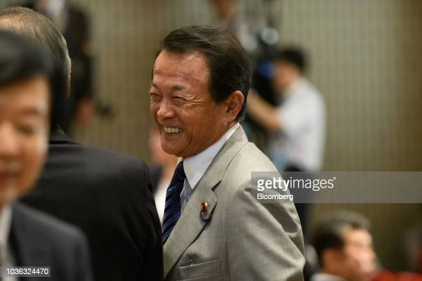 Taro Aso Japan's finance minister arrives for the Liberal Democratic Party's presidential election at its headquarters in Tokyo Japan on Thursday...