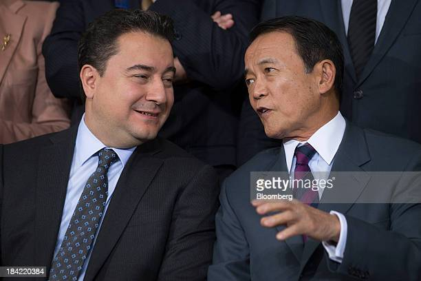 Taro Aso Japan's finance minister right talks to Ali Babacan Turkey's deputy prime minister at the International Monetary Fund governors group...