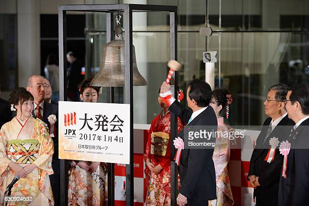 Taro Aso Japan's finance minister rings the opening bell during a ceremony marking the first trading day of the year at the Tokyo Stock Exchange in...