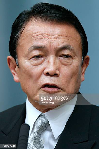 Taro Aso Japan's newly appointed deputy prime minister and minister for finance and financial services speaks during a news conference at the prime...
