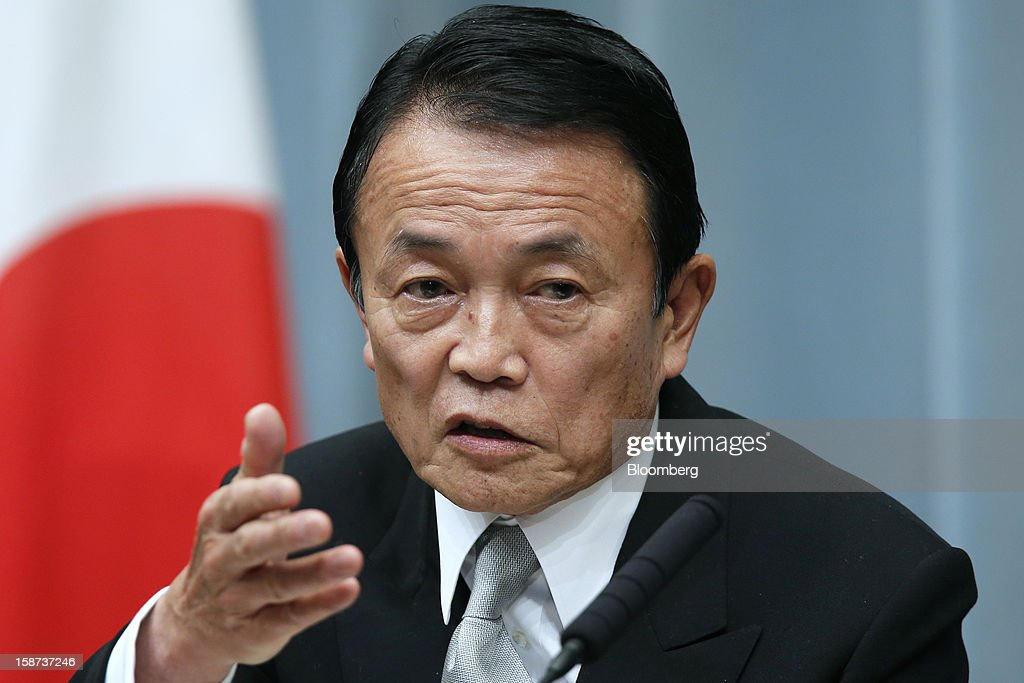 Taro Aso, Japan's newly appointed deputy prime minister and minister for finance and financial services, speaks during a news conference at the prime minister's official residence in Tokyo, Japan, on Thursday, Dec. 27, 2012. Japan's parliament confirmed Shinzo Abe as the nation's seventh prime minister in six years, returning him to the office he left in 2007 after his party regained power in a landslide election victory last week. Photographer: Kiyoshi Ota/Bloomberg via Getty Images