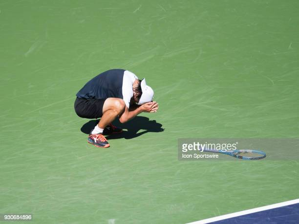 Taro Daniel falls to his knees after defeating Novak Djokovic in the men's singles during the BNP Paribas Open on March 11 at the Indian Wells Tennis...