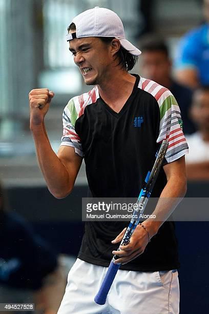 Taro Daniel of Japan celebrates a point against Michal Przysiezny of Poland during day two of the ATP World Tour Valencia Open tennis tournament at...