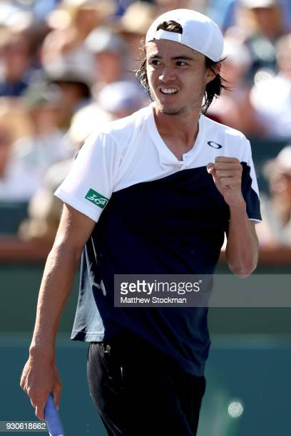 Taro Daniel of Japan celebrates a point against Novak Djokovic of Serbia during the BNP Paribas Open at the Indian Wells Tennis Garden on March 11...