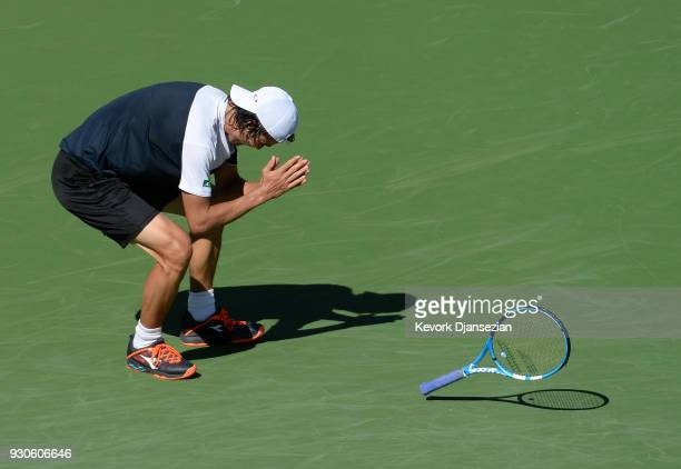 Taro Daniel of Japan celebrates after defeating Novak Djokovic of Serbia during Day 7 of the BNP Paribas Open on March 11 2018 in Indian Wells...