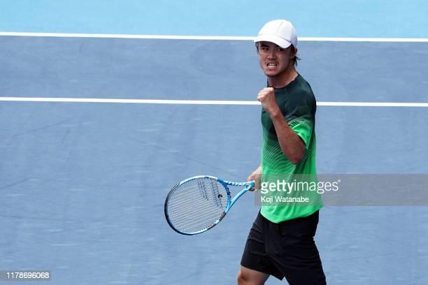 Taro Daniel of Japan celebrates after Jordan Thompson of Australia on day four of the Rakuten Open at the Ariake Coliseum on October 03, 2019 in...