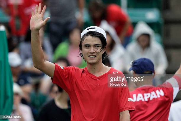 Taro Daniel of Japan celebrates after winning his singles match against Tomislav Brkic of Bosnia and Herzegovina during day one of the Davis Cup...