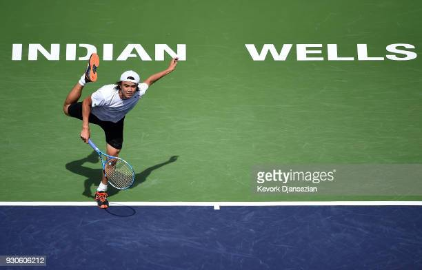Taro Daniel of Japan celebrates serves against Novak Djokovic of Serbia during Day 7 of the BNP Paribas Open on March 11 2018 in Indian Wells...