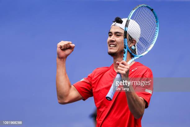 Taro Daniel of Japan celebrates the victory after the Men's Singles match against Zhang Ze of China on day one at Guangdong Olympic Sports Center...