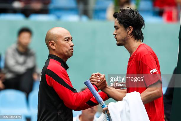 Taro Daniel of Japan celebrates the victory with the Japan team captain Satoshi Iwabuchi after the Men's Singles match on day one of the 2019 Davis...