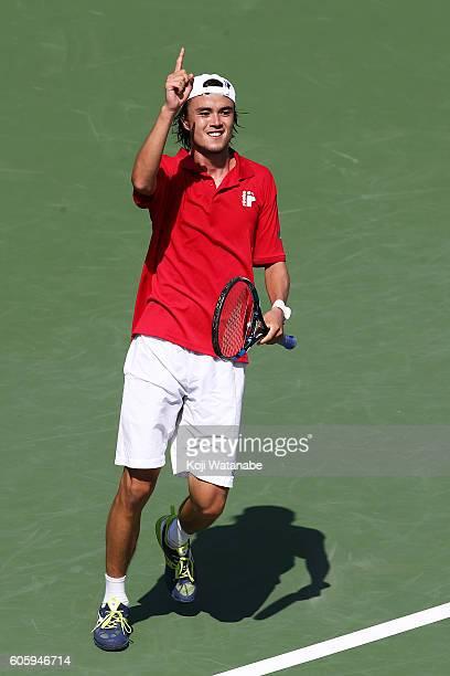 Taro Daniel of Japan celebrates the winner Sergiy takhovsky of Ukraine during the Davis Cup World Group Playoff singles match at Utsubo Tennis Center...