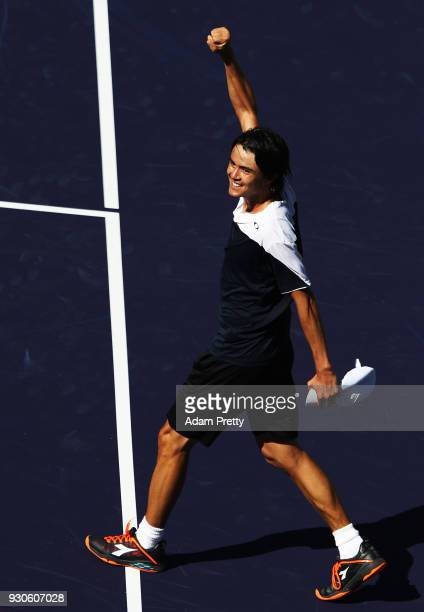 Taro Daniel of Japan celebrates winning his match against Novak Djokovic of Serbia during the BNP Paribas Open at the Indian Wells Tennis Garden of...