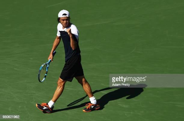 Taro Daniel of Japan celebrates winning his match against Novak Djokovic of Serbia during the BNP Paribas Open at the Indian Wells Tennis Garden of...