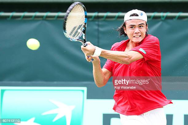 Taro Daniel of Japan competes against Artem Smirnov of Ukraine during the Davis Cup World Group Playoff singles match between at Utsubo Tennis Center...