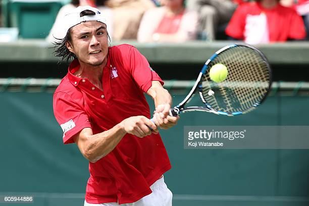 Taro Daniel of Japan competes against Sergiy takhovsky of Ukraine during the Davis Cup World Group Playoff singles match at Utsubo Tennis Center on...