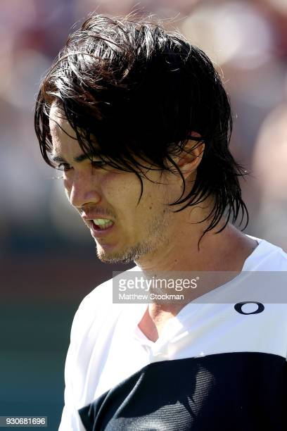Taro Daniel of Japan cools down after his match against Novak Djokovic of Serbia during the BNP Paribas Open at the Indian Wells Tennis Garden on...