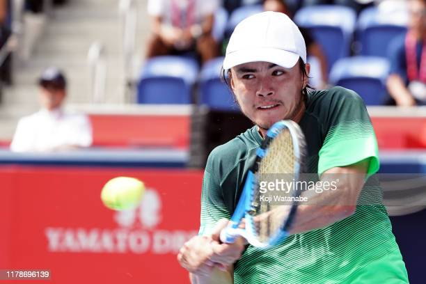 Taro Daniel of Japan hits a return shot against Jordan Thompson of Australia on day four of the Rakuten Open at the Ariake Coliseum on October 03,...