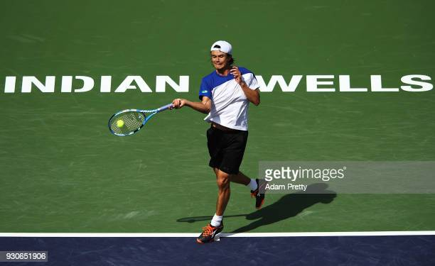 Taro Daniel of Japan hits a shot during his match against Novak Djokovic of Serbia during the BNP Paribas Open at the Indian Wells Tennis Garden of...