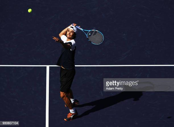 Taro Daniel of Japan hits smash during his mastch against Novak Djokovic of Serbia during the BNP Paribas Open at the Indian Wells Tennis Garden of...