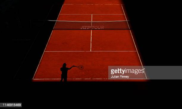Taro Daniel of Japan in action against Albert RamosVinolas of Spain during day one of the Mutua Madrid Open at La Caja Magica on May 04 2019 in...